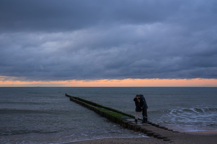 Ahrenshoop Ostsee Wellenbrecher Sonnenuntergang Gummistiefel